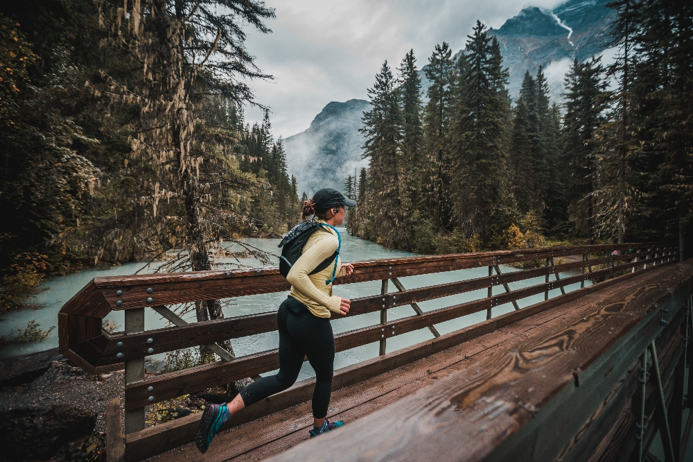 Runner makes her way across the Kinney Lake bridge  Photo: Boosted Imagery